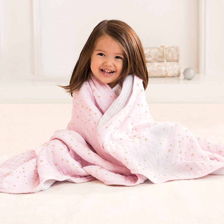 Wrap your precious girl in a beautiful blanket like Aden + Anais Dream Blanket in Metallic Primrose | Isn't She Lovely - SugarBabies Blog